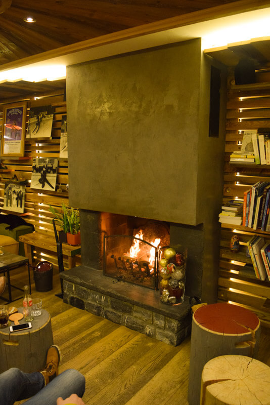 Skiing in Morzine, France - La Bergerie by the fireplace
